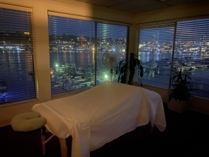 Massage table in a room with a night view